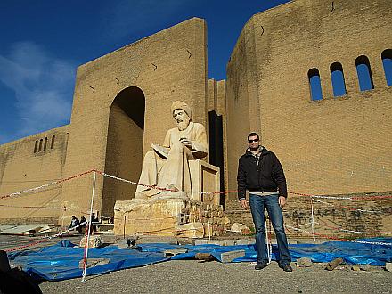 me in front of Ibn Al-Mustawfy statue