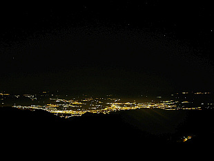 Granada in the middle of the night seen from Sierra Nevada mountains