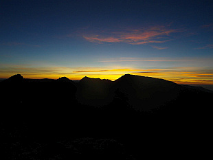sunrise behind Mulhacen (3482m, highest mountain of Iberia Peninsula) seen from top of Pico del Veleta (3398m)