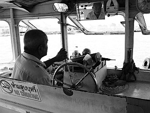 sharp look of the boatman on the Chao Phraya River