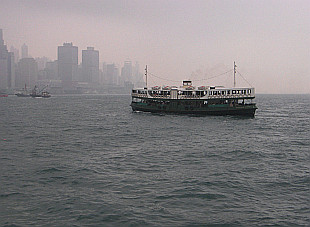 Star Ferry going from Tsim Tsa Tsui on a foggy morning