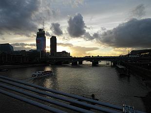 sun sets above western London