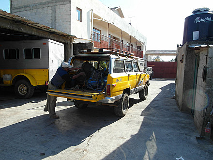 loading a 4WD jeep and departing to Base Camp