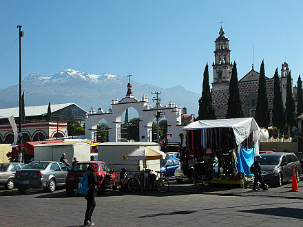 church in Amecameca and Iztaccihuatl rising above