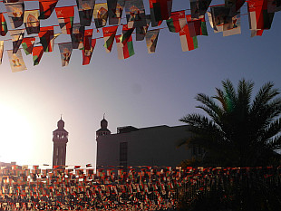 Oman flags in sunset light