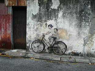 bike hanging on the wall and kids painted