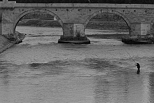 fisherman, river Vardar and Stone Bridge