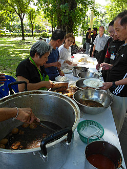 people share food in one of the Bangkok parks