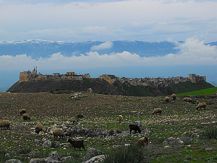 view from Apamea towards fortified village and snowcapped Coastal Mountains